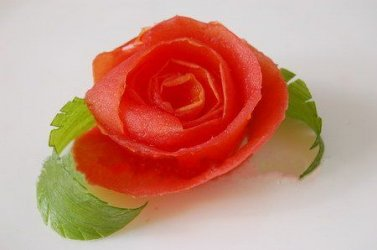 Carving flowers. Appetizing bright rose of tomato.